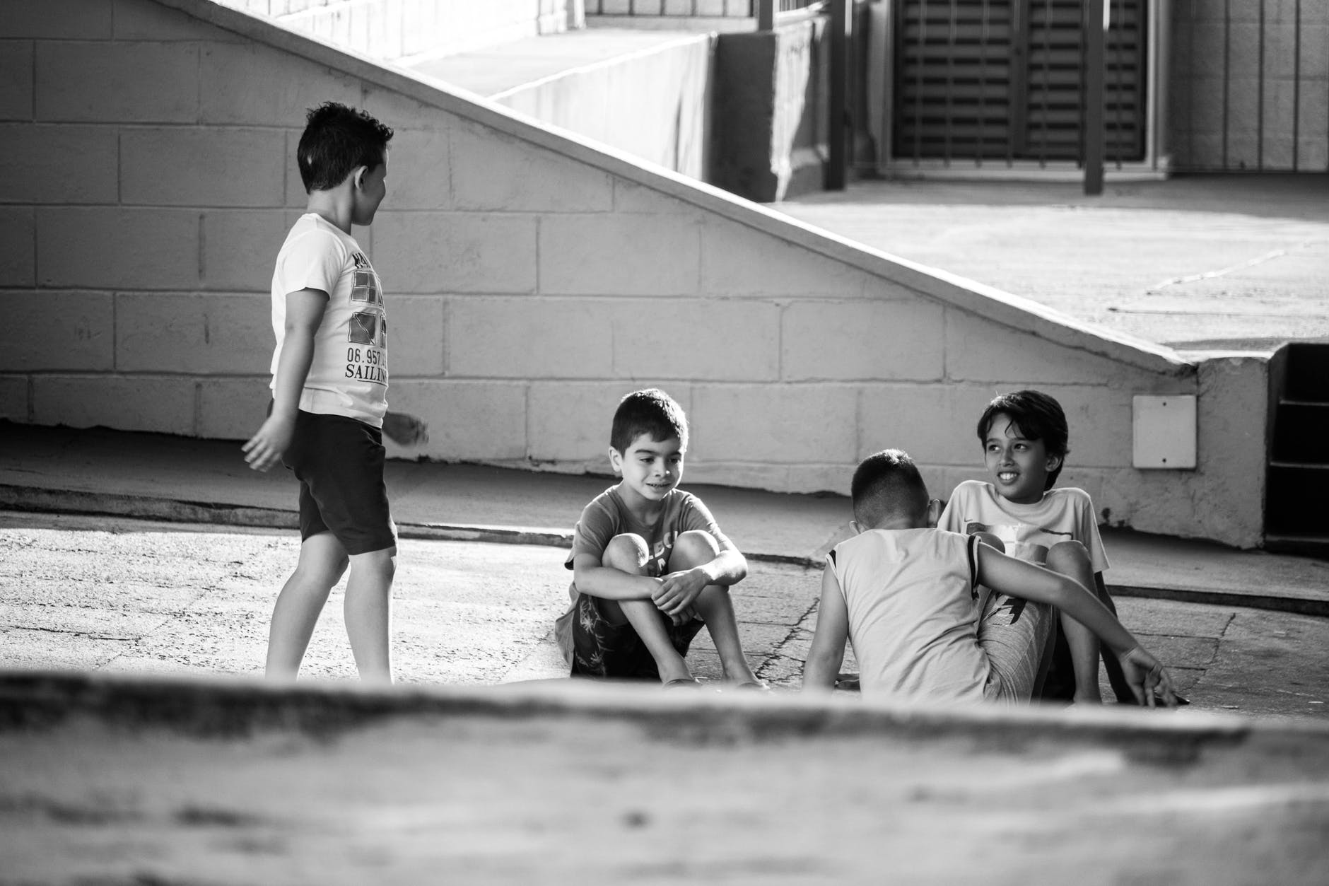 four boys playing